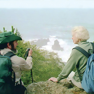 two hikers looking at the ocean