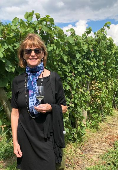 Elizabeth Hans McCrone in vineyard