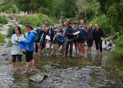 Group of students standing in the Klamath River