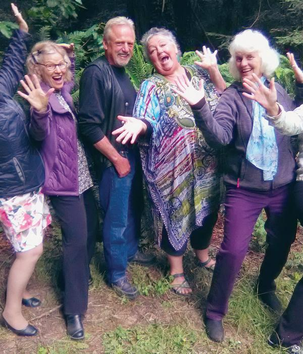 Six very happy people with jazz hands