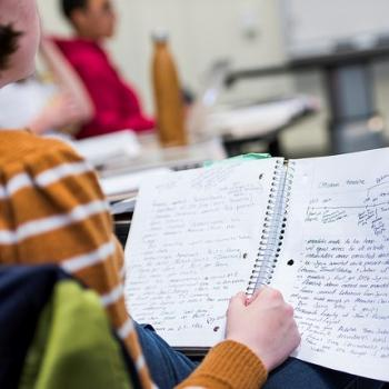 A students notebook with classroom notes written in