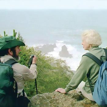 two hikers overlooking the ocean