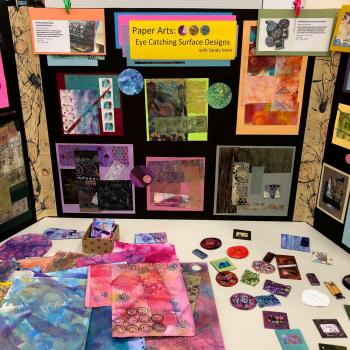 Image of a display at a recent Open House about the Paper Arts class