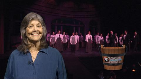 Tracey Barnes-Priestley in front of a stage