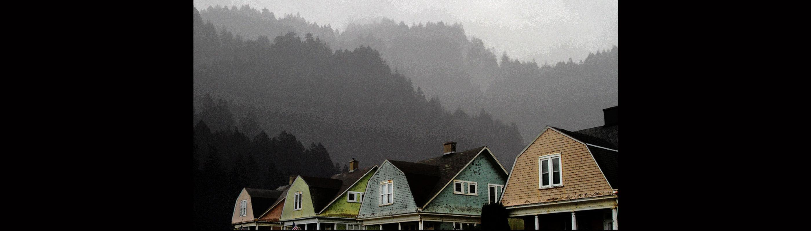 Row of houses with hills in background