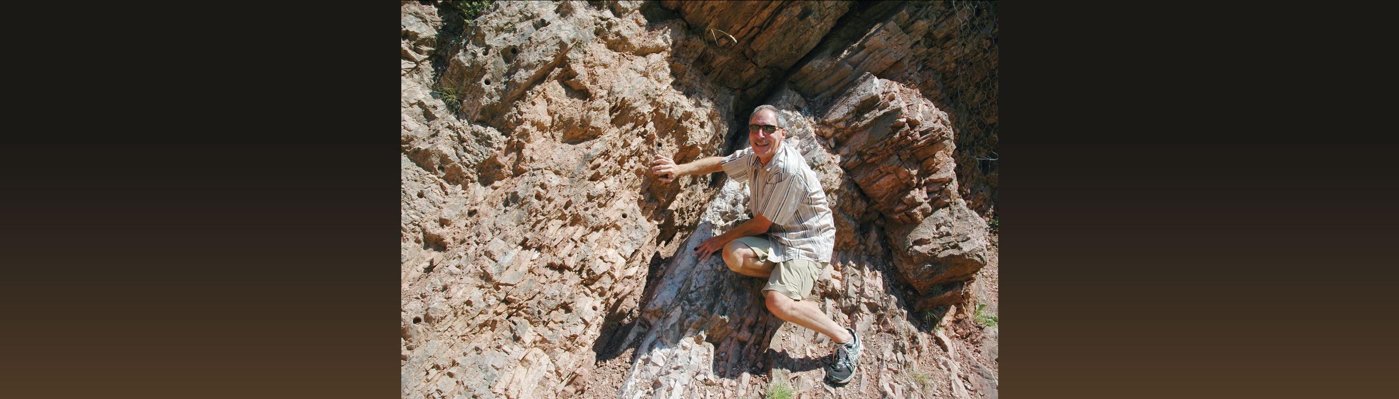 Instructor Mark Bailey on rocks