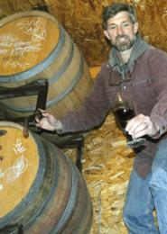 Wil Franklin with wine barrels