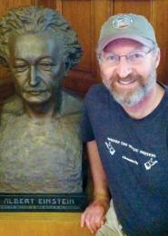 Phil Lazzar posing with bust of Albert Einstein