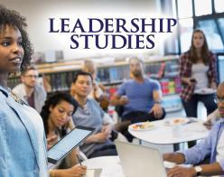 Leadership Studies - Photo of woman presenting to her team